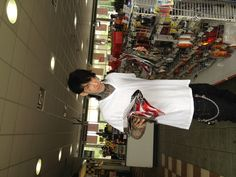I'll never understand the look of a giant ass t-shirt and baggy jeans down to the knees. How to guys walk in this get-up? And don't they realize they look like complete assholes?...Trace Cyrus buys bandmates a special treat at the corner store.