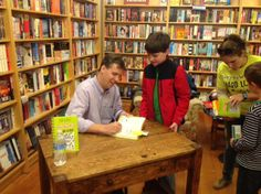 Jeff Kinney signing books at the Diary of a Wimpy Kid: Hard Luck event
