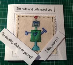 This colourful robot card was made by sewing layers of organza onto a canvas background. The finished result is similar to that of a painted picture but far more special and unique. The needle was my pen and the fabric was my paint. It has to be held in the hand to be fully appreciated. This card would shine out from any others in a line up. It would be perfect for framing as a special memento to keep long after the event. Each card is individually handmade by me in my studio so small…