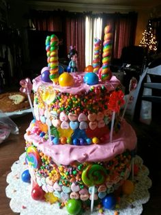 Vanellope von Schweetz cake completely covered in candy. Dig in .