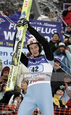 Lars Bystoel of Norway celebrates winning the FIS Ski Jumping World Cup event at the 54th Four Hills ski jumping tournament on January 4 2006 in...