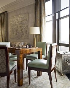 Sleek Chairs And Game Table In Room By Designer S R Gambrel
