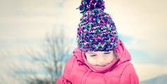 Fashion portait of a little girl in winter clothes having fun in - Fashion portait of a little girl in winter clothes having fun in the snow