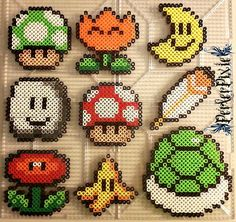 Here are some Mario themed perlers! The perlers are as follows. ~1-UP Mushroom ~Fire Flower ~Moon ~Cloud ~Grow Mushroom ~Feather ~Fire Flower ~Banana ~Koopa Shell