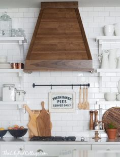 White Kitchen with wood range hood | The Lilypad Cottage