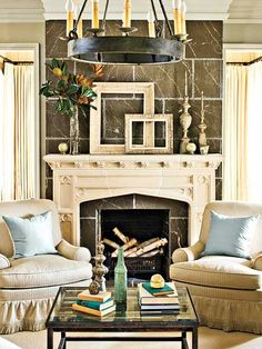 This living room is decorated with casual pieces that complement its formal architecture. The neutral palette -- accented with soft blue pillows and accessories -- has the timeless appeal of a sepia-toned photograph. (Photo: Laurey W. Glenn)