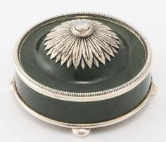 A Fabergé silver-mounted carved hardstone bell push, workmaster Johan Viktor Aarne, St. Petersburg, 1898-1904, with silver beaded border, the domed top chased with acanthus leaves, with moonstone push, raised on four bun supports.