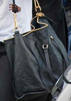 love this slouchy black LV bag