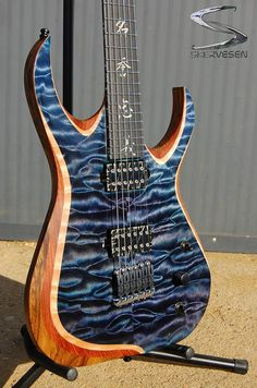 Skervesen Model Nebelung but with middle layer that's not included in production version. Body: black limba, middle layer : bubinga, top: quilted maple AAAAA grade, high gloss finish. Ebony fretboard with kanji inlay (7 virtues of bushido). Bare Knuckle Pickups Juggernauts calibrated set in black battleworn covers.