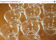 SPRING SALE Vintage FRENCH Arcoroc Clear Glass Punch Cups Set of 4. $12.80, via Etsy.