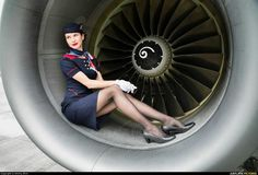 Every time I try to take a photo of a Jet Engine, a bloody stewardess wants to be in the picture.... - Album on Imgur