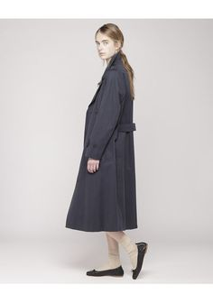 Margaret Howell, trench coat in navy and flats.