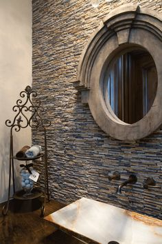 Guest bathroom with an elegant, yet organic feel with its wall of stone.