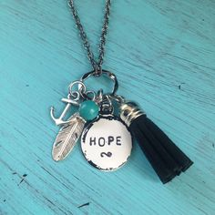 HOPE Charm Tassel Necklace by JewelryWithWords on Etsy https://www.etsy.com/listing/246337686/hope-charm-tassel-necklace