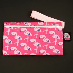 Mini Pink Flamingo Handbag:These are great because you can use them as a little clutch or wristlet. They are also a perfect size for cosmetics, coupons, money, pens, or just all those little things that fall to the bottom of your bag! They are designed to fit into any Dolly bag nice and flat 8.5