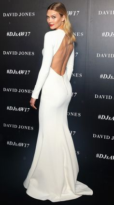 Karlie Kloss in an open-back white Rebecca Valance dress - click ahead for more better-from-the-back looks