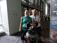 May 2012...after photo of us with one of the many pig statues that decorate the convention center venue..PIGGIPIDIES