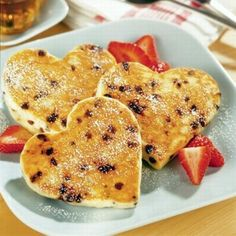 Pamper your Valentine with this charming recipe for Heavenly Heart-Shaped Pancakes. Dotted with mini semi-sweet chocolate morsels and sprinkled with powdered sugar, this fun breakfast treat brings a touch of heaven to kids and adults alike. Valentines Day Chocolates, Valentines Day Food, Valentine Treats, Valentines Breakfast, Valentine Chocolate, My Funny Valentine, Valentine Heart, Heart Shaped Pancakes, Chocolate Chip Pancakes