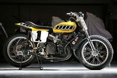 """# 2 - Kenny Roberts and the Legendary 1975 Yamaha TZ750. He achieved legendary status when he fielded a dirt-tracker powered by a TZ750 two-stroke roadracer engine at the Indianapolis Mile in 1975, made a dramatic last-lap pass for the win and made the classic statement: """"They don't pay me enough to ride that thing."""""""