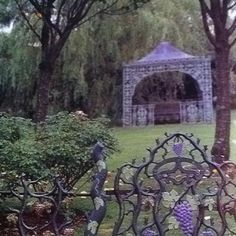 Both the cast iron gazebo and grape vine design fence still have their original paint from the 1870s.