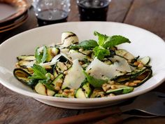 Zucchini sliced lengthwise grills up beautifully. Just toss it with some Romano cheese, crunchy pine nuts and a tangy vinaigrette to create a grill-master side dish.