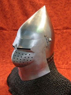 Late 14th to early 15th century bascinet based on contemporary artwork. Note the bevor plate under the visor. Made by Jeff Wasson.