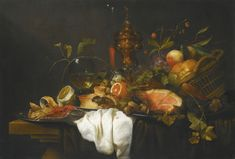 Joris van Son A 'PRONK' STILL LIFE OF FRUITS IN A BASKET TOGETHER WITH A GILT GOBLET, WINE GLASS, A HAM, A PIE, ORANGE, LEMON AND A CRAB, ALL UPON A TABLE DRAPED WITH BLUE AND WHITE CLOTHS
