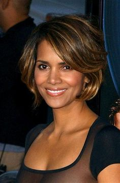 Beautiful! DO style a bouncy bob like Halle Berry did for an effortlessly glam look. Her blond highlights are a pretty touch, too.