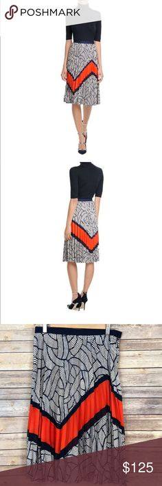 "Diane von Furstenberg DVF Saphira Skirt Size 6 Diane von Furstenberg DVF Saphira navy Orange Mixed-Print Pleated Skirt. A bold orange panel and a graphic print in navy and white lend modern cool to the pristine pleats of this 'Saphira' skirt from Diane von Furstenberg. Navy and white printed fabric with orange detail, zipped fastening. Slim silhouette, over-the-knee length  MATERIAL & CARE 100% Polyester Dry clean New with tag Size: 6  Waist: 14.5"" laying flat Length: 27"" Diane Von…"