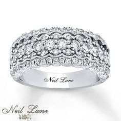 Scalloped edges and milgrain pair beautifully with sparkling round diamonds in this breathtaking anniversary band from Neil Lane Bridal®. Styled in 14K white gold, the ring for her has a total diamond weight of 1 1/4 carats and features Neil Lane's signature inside the band. Diamond Total Carat Weight may range from 1.23 - 1.28 carats.