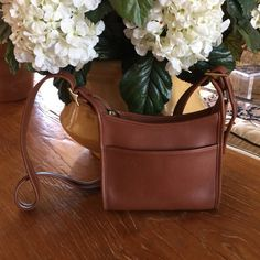 """St. Patty's Day Sale Vintage Coach Leather Bag REDUCED FROM $75Vintage Coach British Tan Leather Crossbody Bag. Gently Worn. Very Good Used Condition.  Slight Marks At Exterior, Strap and Piping.  Brass Hardware.  Purchased More Than 15 Years Ago.  Measures = 8"""" L x 2.5"""" D x 7.25"""" H, Strap Drop At Longest = 23"""" Coach Bags Crossbody Bags"""