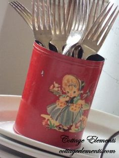 Isnt she a cutie pie! Somebody, probably in the 50s, was verycreative with a vegetable can now werent they. It works perfect as a silverware server!