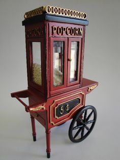 A vintage popcorn cart to meet both the Old Hollywood & Vaudeville ideas.