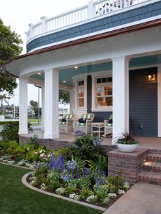Front Porch. Landscaping Ideas. #FrontPorch #Landscaping   Flagg Coastal HomesThe brick is by Eldorado Stone, and the pavers are by Belgard. The porch and railing are by AZEK. The furniture is by Frontgate, and the fabric is by Sunbrella.