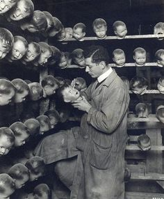 Anonymous. Painting doll heads, circa 1930.  Stop it.  Go AWAY scary heads with no bodies!!!