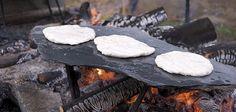 Bannocks baking on a piece of water soaked slate.  Vrangtante Brun's photostream