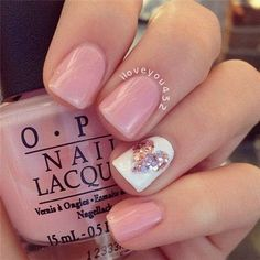 Pink and White Nail Design with a Glittery Heart Accent