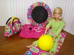 My monkey says barbie needs a gym, looks like an easy diy set. Lots of other ideas on site. Washer/dryer etc.