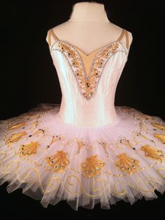 White and gold classical tutu design for Le Corsaire by Variations Ballet Costumes. The bodice is made of white silk dupioni. The embroidery and embellishments are all custom designed and made in the studio. Each layer of the tutu platter is hand pleated of English net.