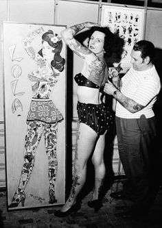 Tattoo artist Les Skuse at work on Pam Nash c. 1960