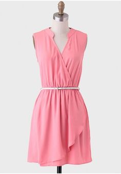 <p>Ideal for Sunday brunch, this pink faux wrap dress features a surplice neckline with a tunic collar and an elastic waistband with a cream-colored faux leather belt. This polished dress can be paired with heels and delicate jewelry for a sophisticated ensemble. Unlined, opaque.</p> <p>100% Polyester<br /> Imported<br />37