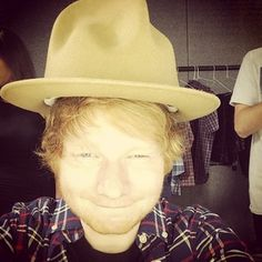 Let's start off with when he stole Pharrell's hat all like ¯\_(ツ)_/¯ | 39 Things Ed Sheeran Did In 2014 That Were Utterly Perfect