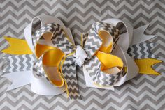 Yellow, white, and grey chevron stacked boutique bow. $5.00