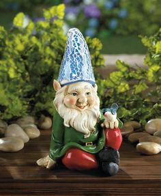 Cheery gnome solar statue.  You'd be happy, too, if a friendly little bluebird was perched on your knee!  This charming garden gnome statue features a tall blue hat that lights up at night after soaking up the sun all day long