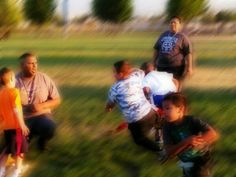 My HoneyChild Isreal Jayco Very center of photo. Blue camouflage design t-shirt and black jeans  @ practice flag football  game. April 2015 W/out frame.