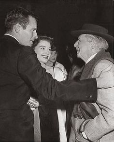 In 1957, architect Frank Lloyd Wright greets actor Charlton Heston and his granddaughter Anne Baxter at his home, Taliesin West. Heston and Baxter were there for a press conference to promote the western Three Violent People. They had acted together the year before in the film The Ten Commandments.