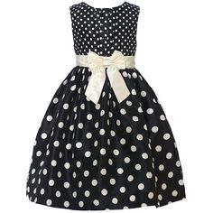 Trendy dress with a fitted bodice, a voluminous skirt and a black ivory contrasting pattern from designer Mia Juliana. The dress features little ivory polka dots on the sleeveless bodice and bigger ones on the flared skirt bringing out a cute visual effec