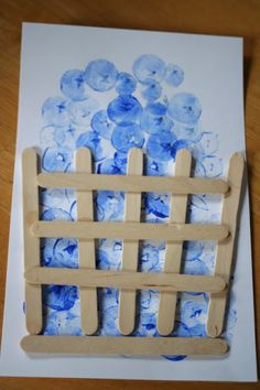 Blueberry stamp craft with paint, a fingerling potato or cork and Popsicle sticks