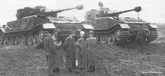 Dr Ferdinand Porsche, with his design staff, standing with two of his Porche Tiger (P) prototypes side by side. Inused chassis would later be used for the the Ferdinand and Elefant tank destroyer series