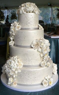 I really like all the fondant or gumpaste flowers, but I'm not a big fan of the details on each tier...easily changed